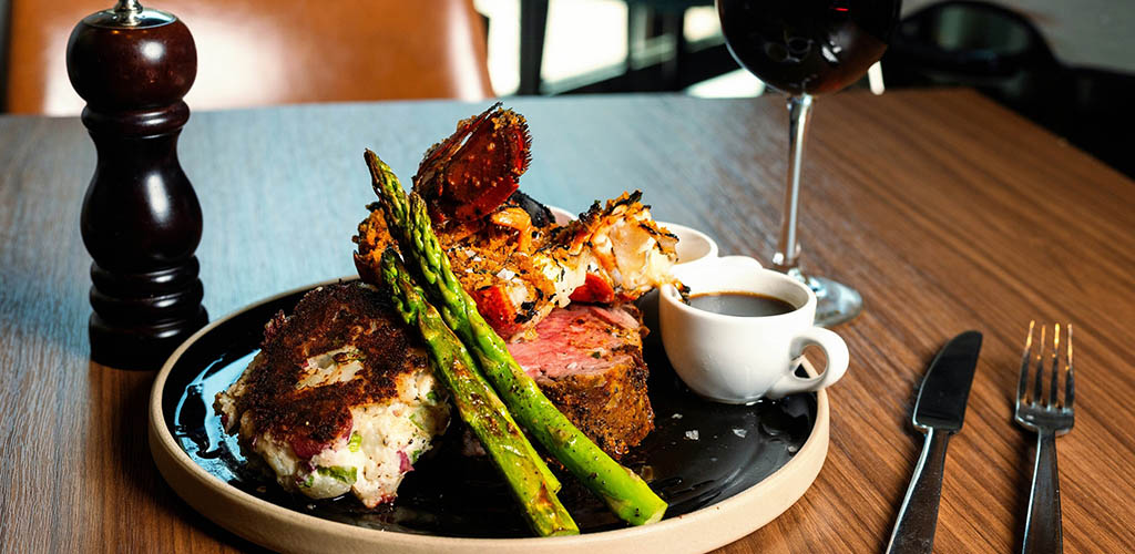 A lobster and steak dish from The Corner Office