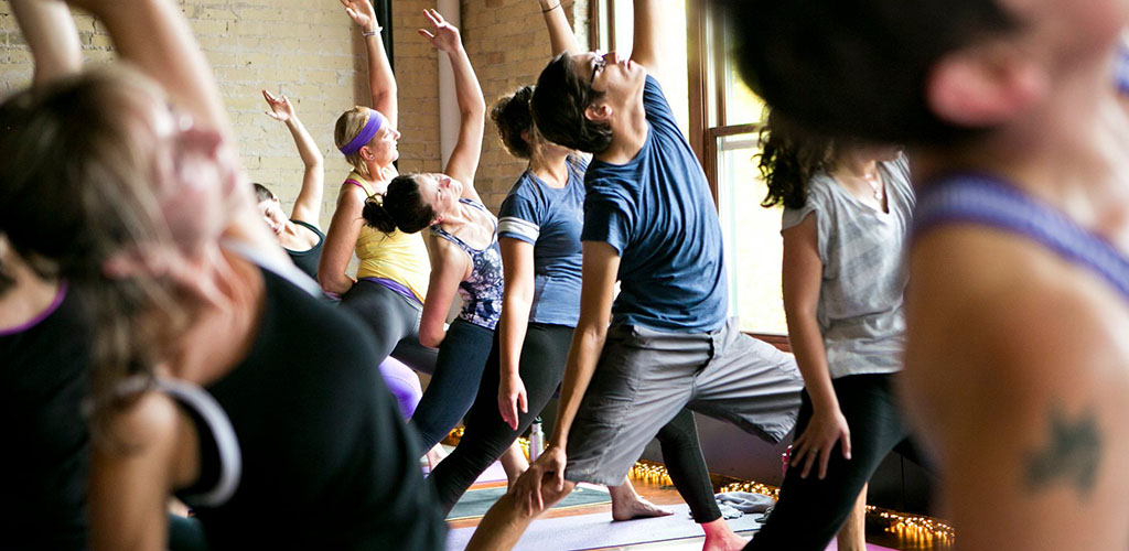 Men and women doing yoga at Join The Studio