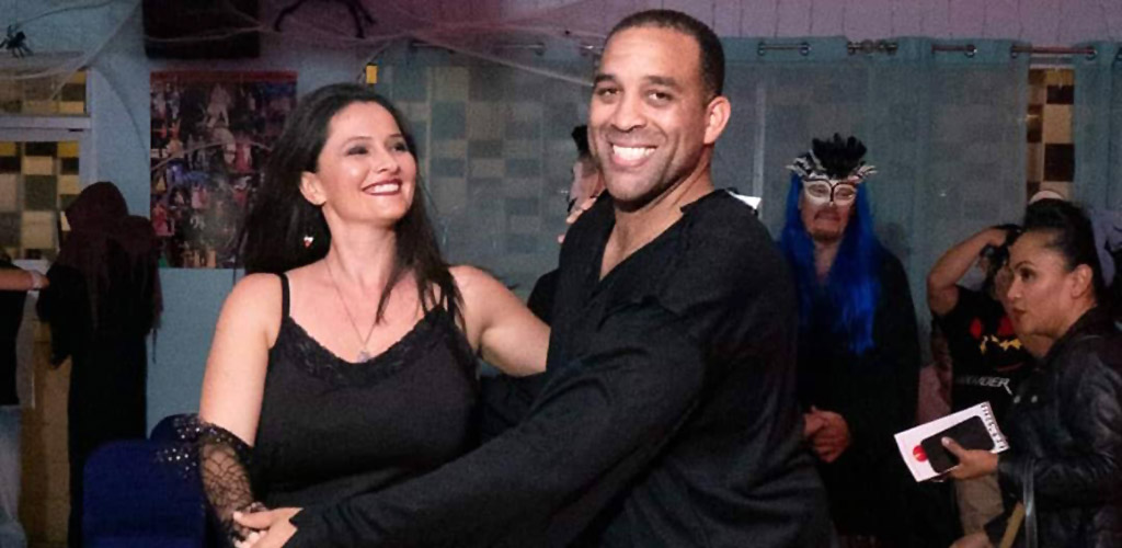 A couple at a dance class in School of Salsa