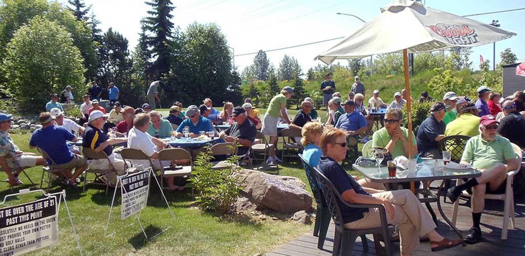 Patrons in the outdoor beer garden of Alaska Bradley House
