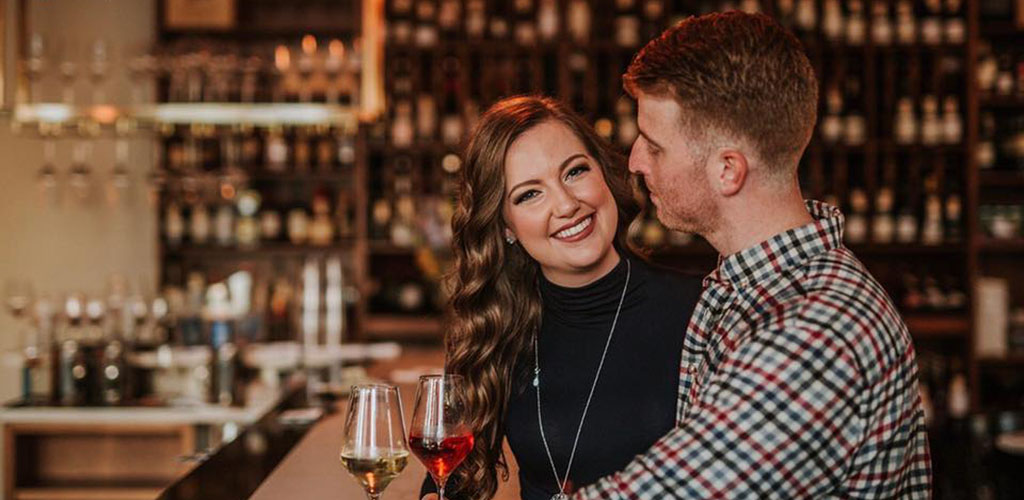 A beautiful woman on a date with a man at Nouvelle Bar & Bottle