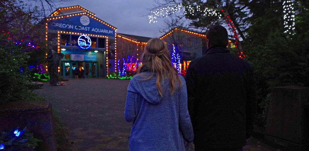 A couple on an evening date at the Oregon Coast Aquarium