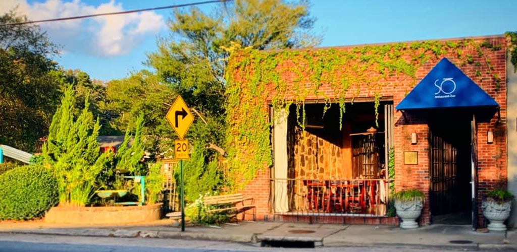 The rustic and green exterior of So Restaurant Bar