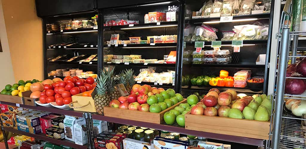 The produce area at Stratton's Market full of fresh fruits and vegetables