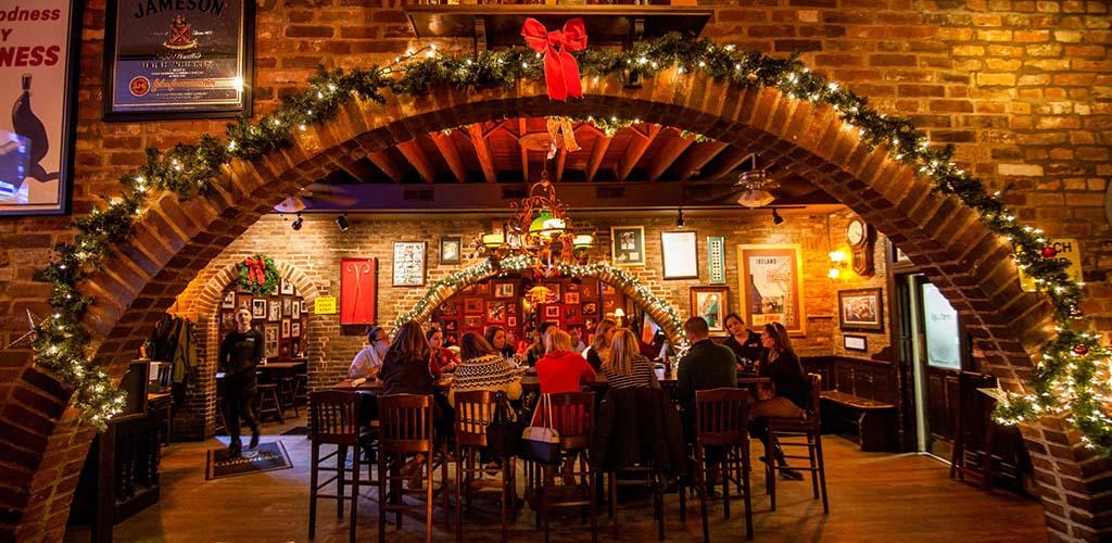 The cozy brick interiors of John D. Mcgurk's Irish Pub