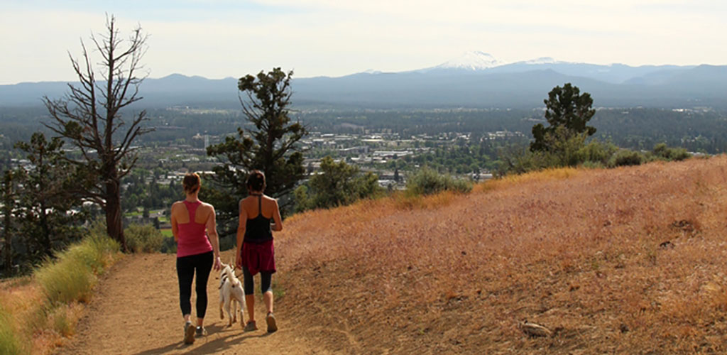 Women walking their dog at Pilot Butte State Park