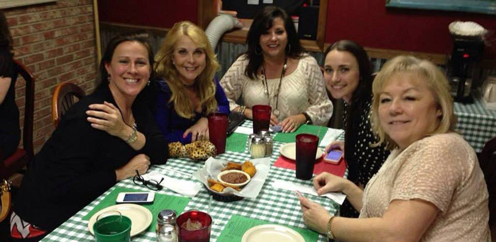 A group of friends having dinner at Angelo's Eatery