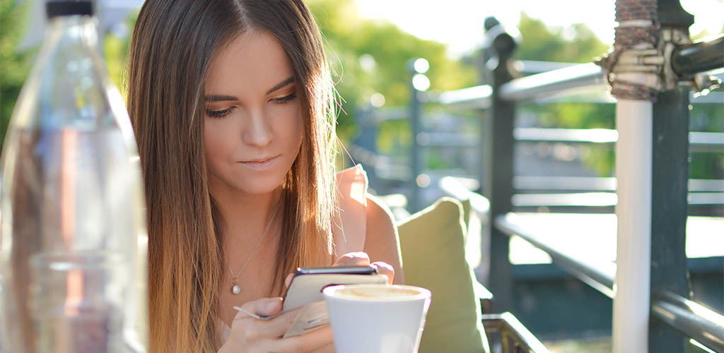 Woman using a free hookup app to find casual sex
