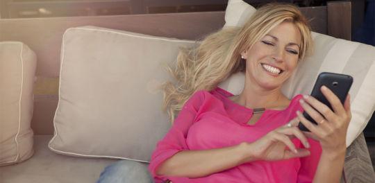 Woman in pink shirt using Australian cougar dating app
