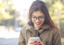 Bellevue dating app being used by woman with red lipstick