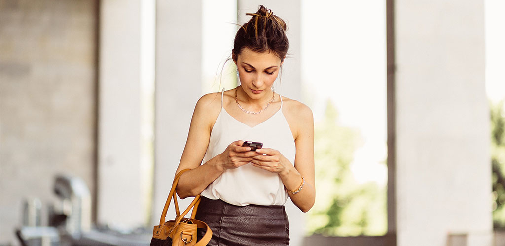 Woman in white blouse in Laredo using a dating app