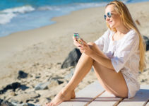 Blonde woman using dating app in St. Petersburg Florida
