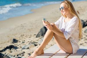 Blonde woman using dating app in St. Petersburg Florida