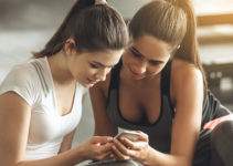 Women trying a dating app at the gym in Syracuse New York