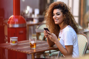Woman in Macon Georgia using a dating app while eating