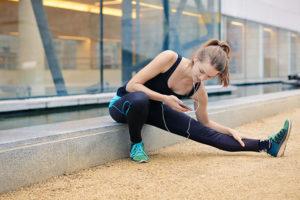 Mesa Arizona woman using a dating app while stretching