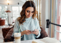 Woman in Southampton England trying out a dating app and drinking coffee