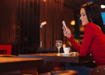Bexley woman using dating apps at a bar