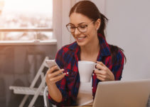 Northampton young woman trying a dating app while drinking coffee