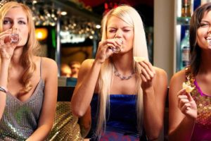 A trio of Fort Collins women at a hookup bar drinking