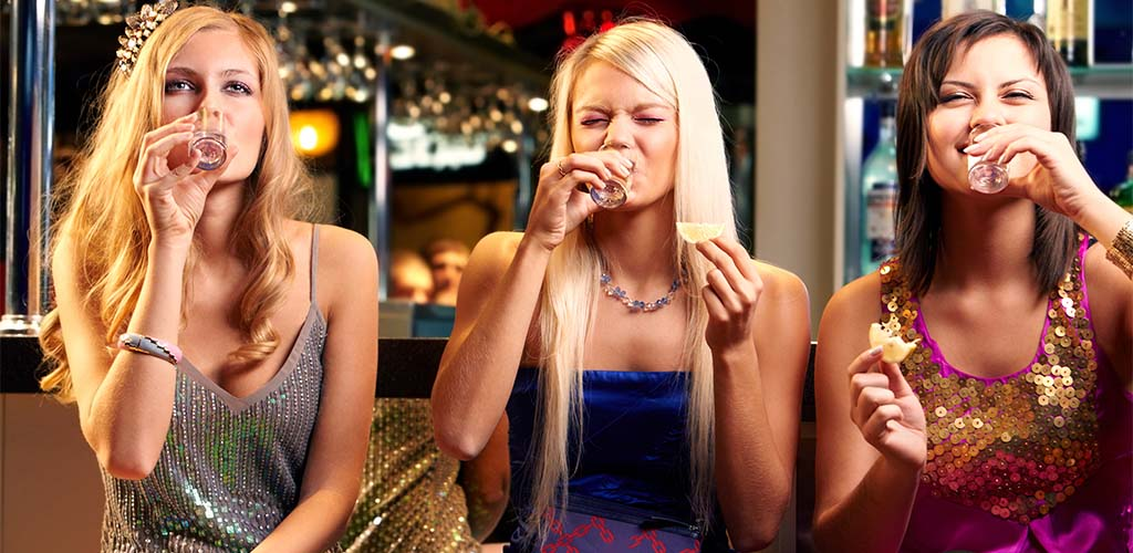 A trio of Fort Collins Colorado women at a hookup bar drinking