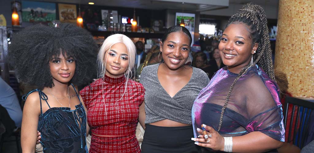 A group of black women at Tailored Smoke Cigar Lounge