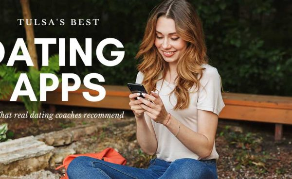 A woman using the best dating apps and sites in Tulsa while at a park