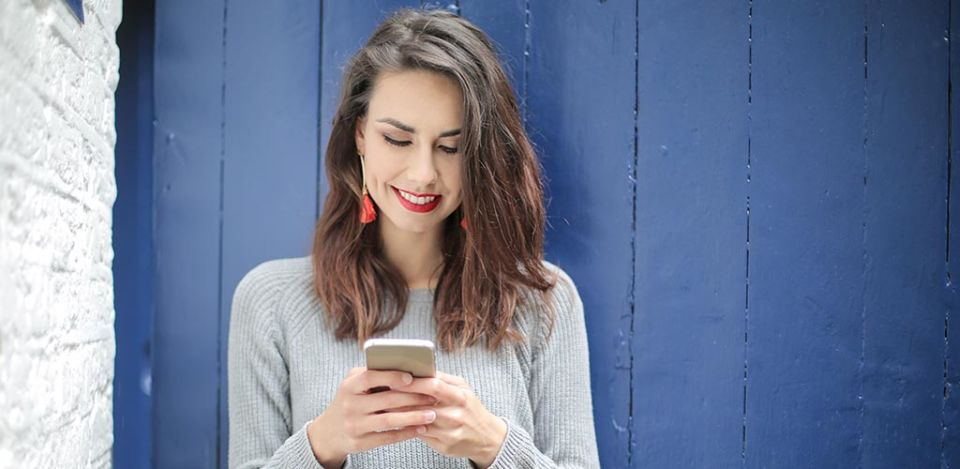 Young woman getting a text she likes