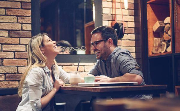 Man with glasses showing his pretty date how to be charming man