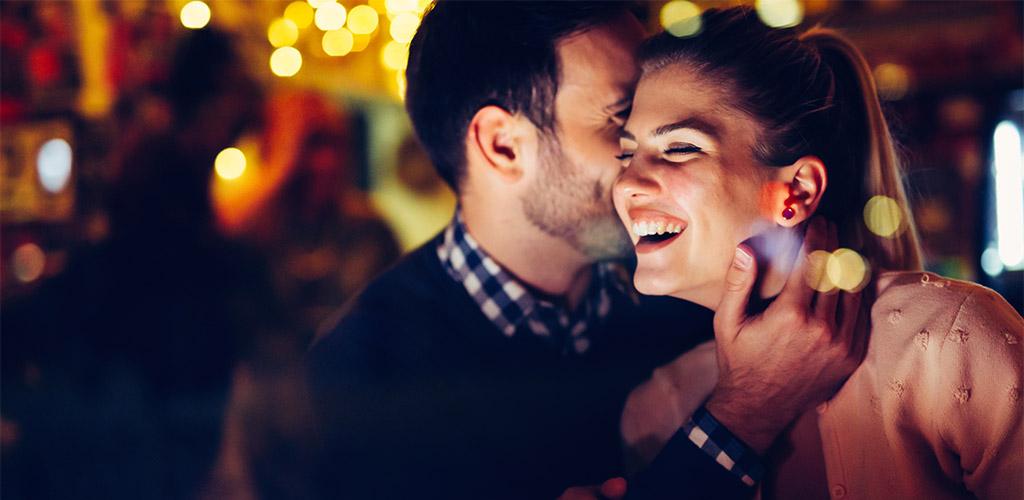 Couple at a Houston hookup bar whispering