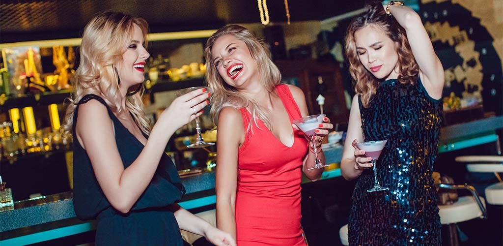 Three women at an Oklahoma City hookup bar drinking
