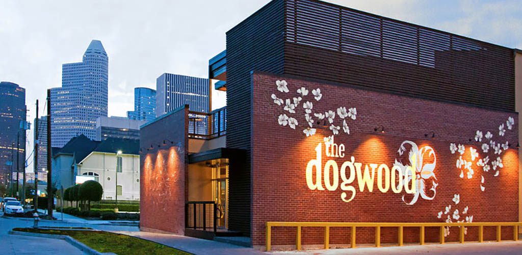 The Dogwood bar with its flower mural over brick exterior