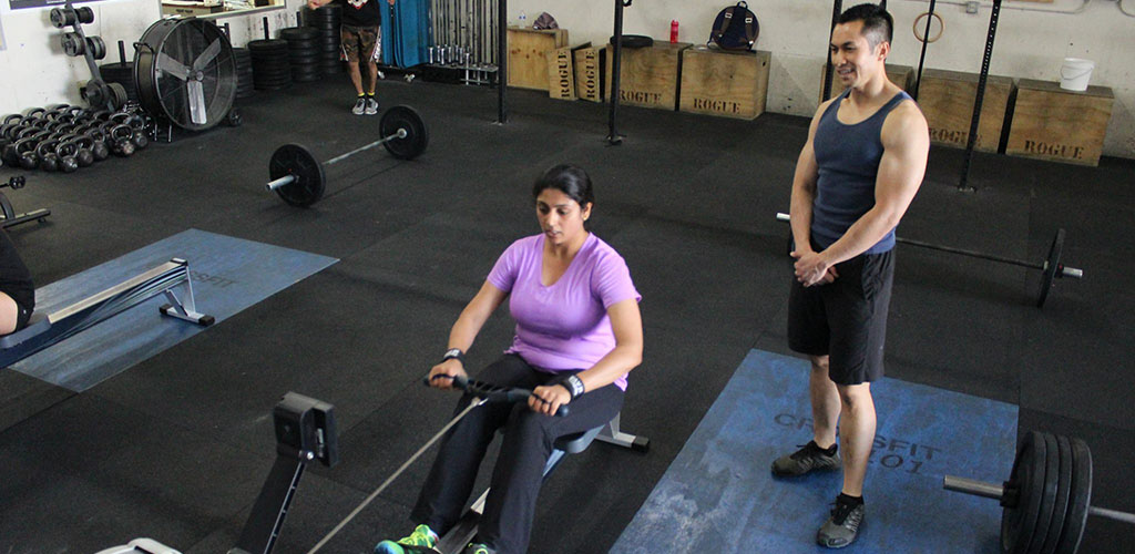 Working out at the rowing machine at Crossfit 101