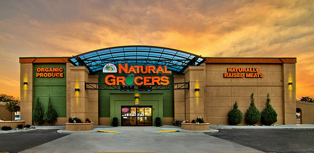 Natural Grocers exterior at dusk