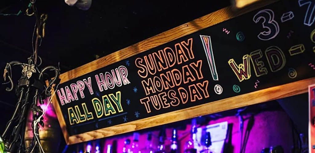 The Grapevine Bar happy hour sign