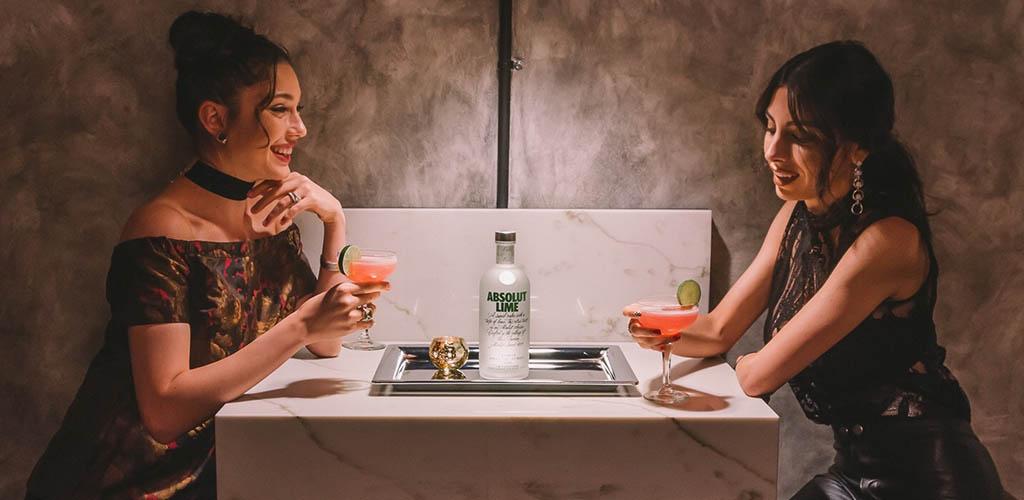 Two women enjoying drinks at Melrose Station