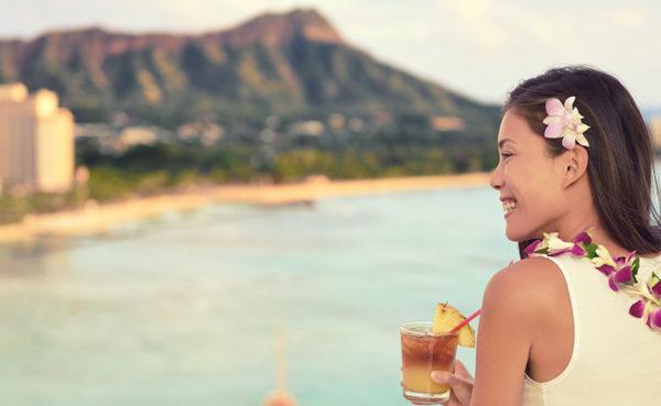 Hawaiian woman drinking a cocktail and finding Honolulu Hawaii hookups