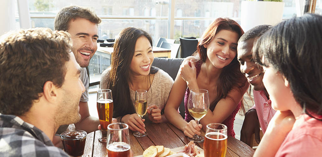 Group of singles enjoying drinks and looking for Fremont California hookups in a rooftop bar