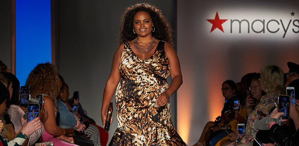 A plus-size woman modeling clothes from Macy's