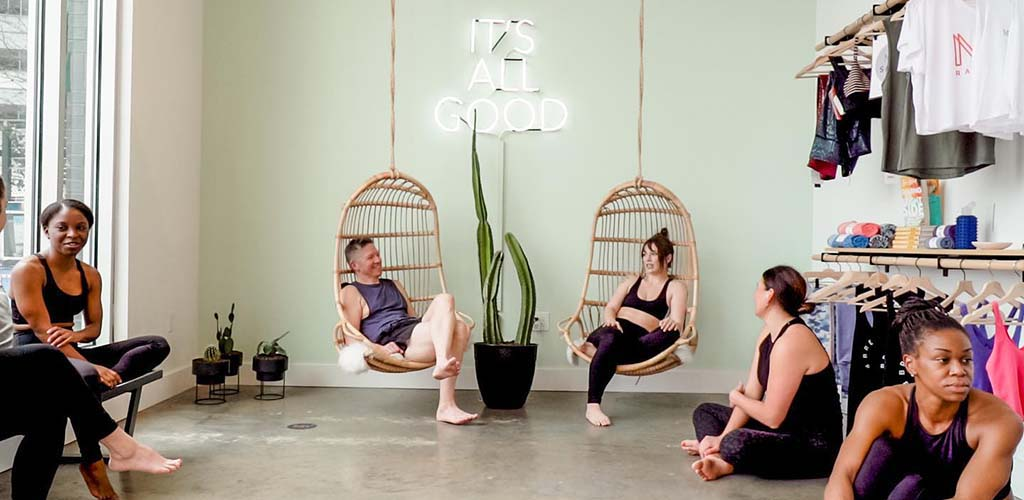 Women hanging out before class at Midtown Yoga Studios
