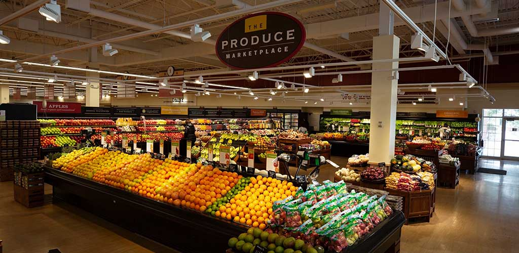 Heinen's Grocery produce section with a row of various citrus fruits in front