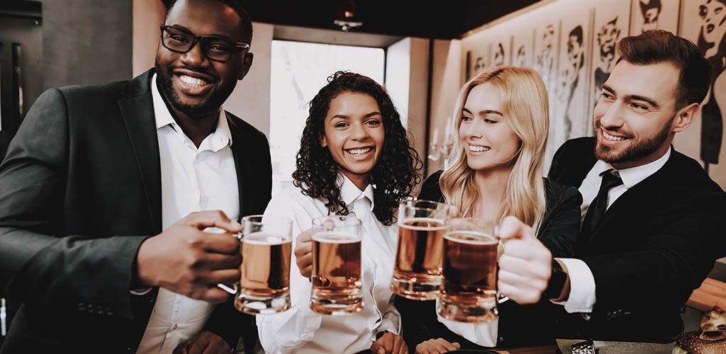 Young professionals enjoying beers at a bar while looking for Durham North Carolina hookups