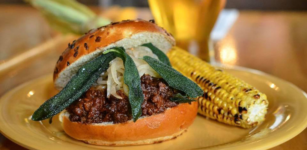 A burger and roasted corn from Beachwood BBQ