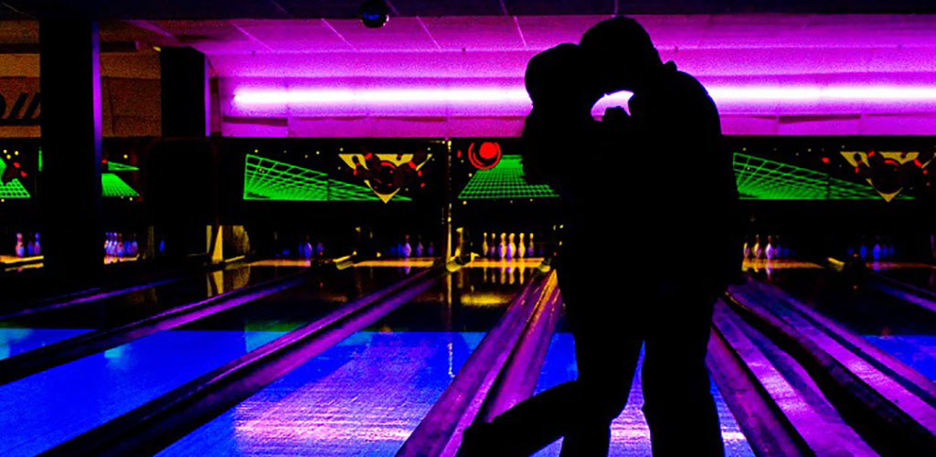 A couple on a date at Cowtown Bowling Palace