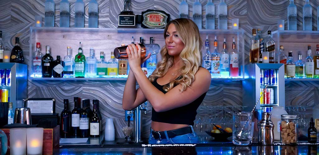 Attractive bartender mixing drinks at D-Tour Martini Bar - a great place to get laid in Buffalo