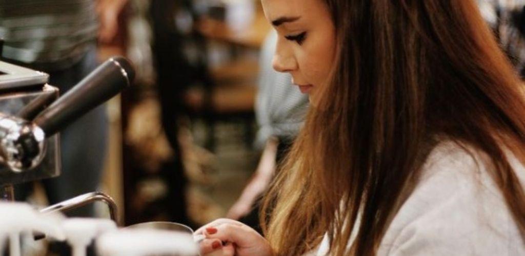 A cute Boise girl enjoying coffee at Awakening