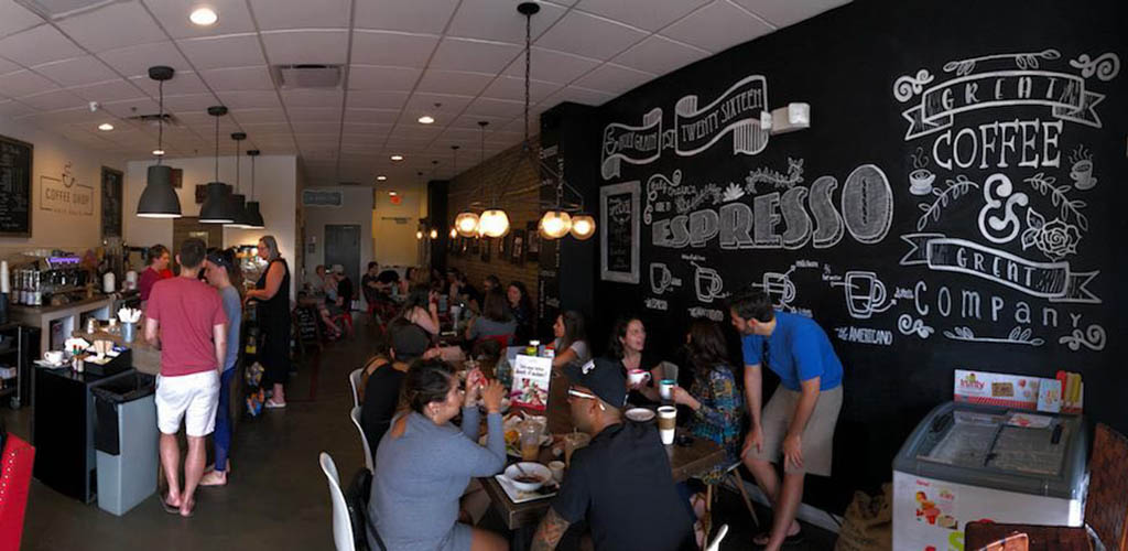 A busy day at Holy Grain Coffee Shop, filled with people mingling