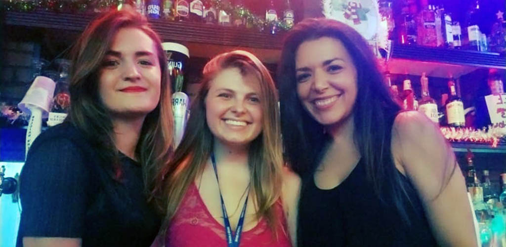 3 beautiful young ladies smiling at the bar in Murphy's Pub and Lounge