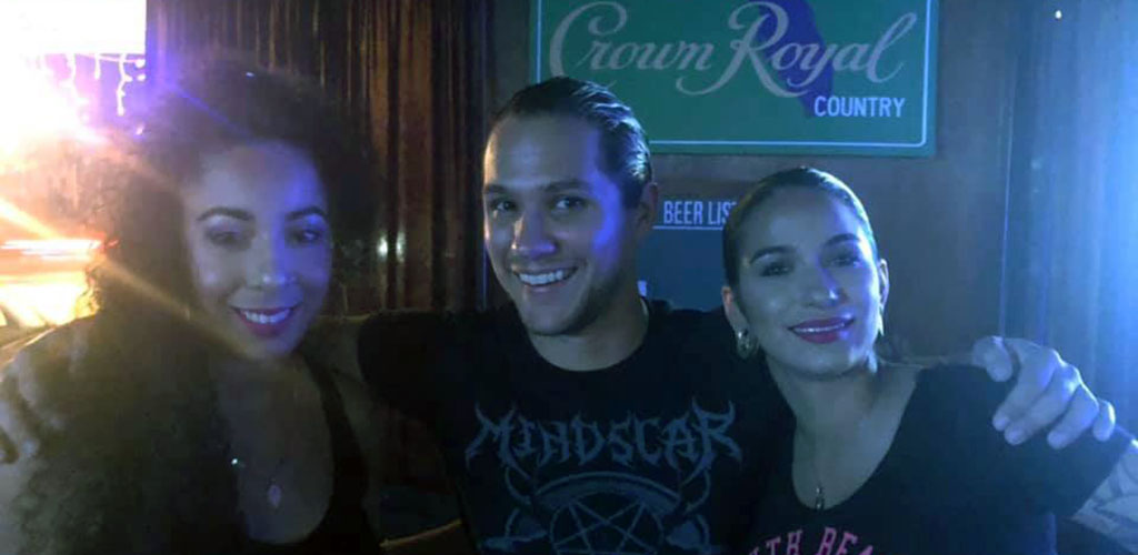 Three young people having a great time and looking to hookup at St. Matthew's Tavern at the Orlando Beer Garden
