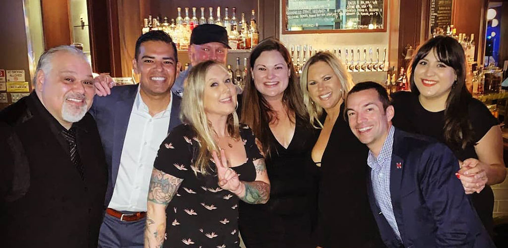 A group of friends enjoying an evening at The Stave Bar